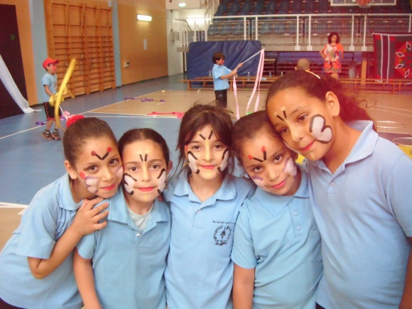 Girls enjoying the day and showing off their face paint.