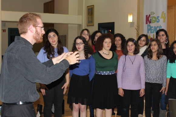 """The Jerusalem Youth Chorus performs.  """"Don't pay no mind to the demons / They fill you with fear /  The trouble it might drag you down / If you get lost, you can always be found / Just know you're not alone / Cause I'm going to make this place your home"""""""