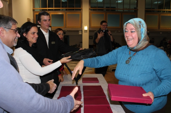 The Kids4Peace Jerusalem steering committee recognizes Arwa, Muslim advisor and coordinator.